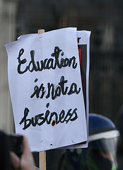 sign in the air during protest stating education is not a business