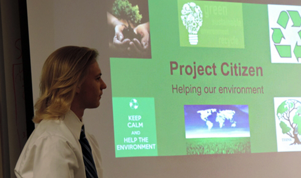 man giving presentation of project citizen helping our environment
