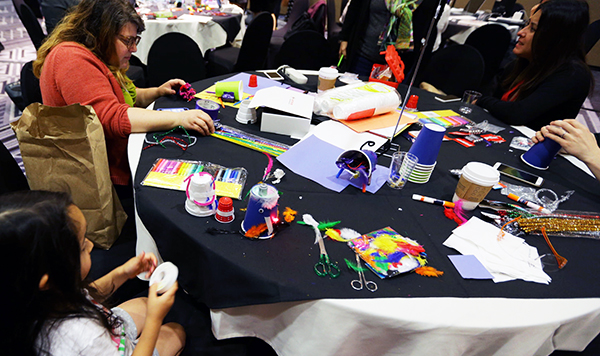 People doing a craft project at a conference table