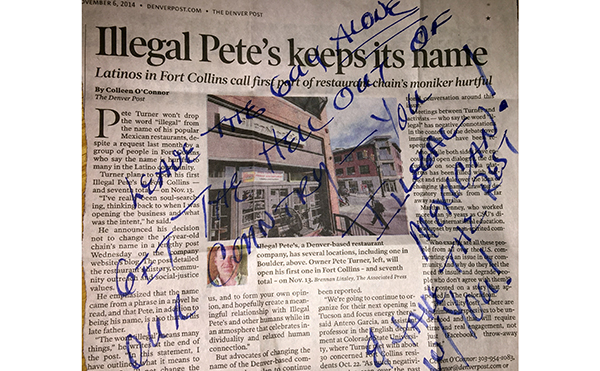 Racist comment handwritten on newspaper
