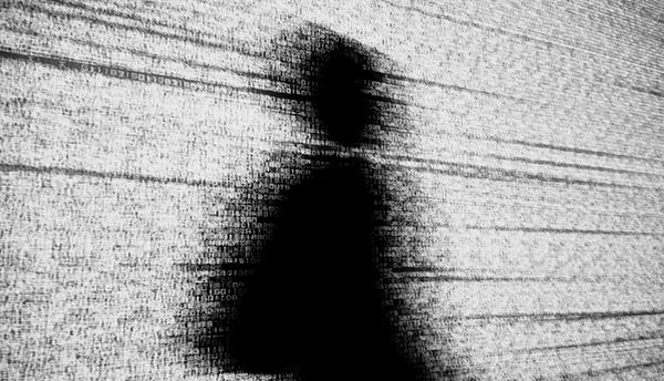 Human shadow made of codes depicting online privacy issue