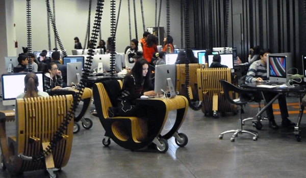 Group of young people working at individual computer stations