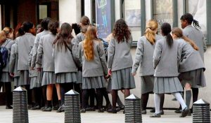 Group of London-based students in school uniform