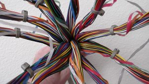 hand holding multi-colored wires