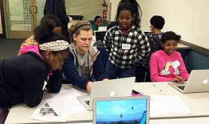4 kids in classroom learning computer program