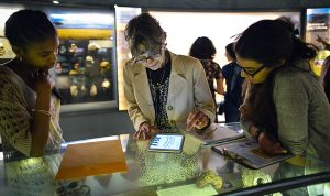 museum patrons using tablet in museum.