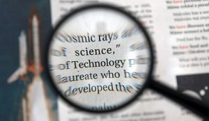 magnifying glass on newspaper