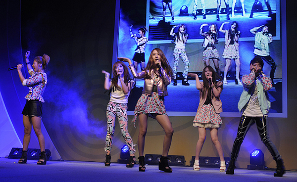 Korean pop group sings on stage