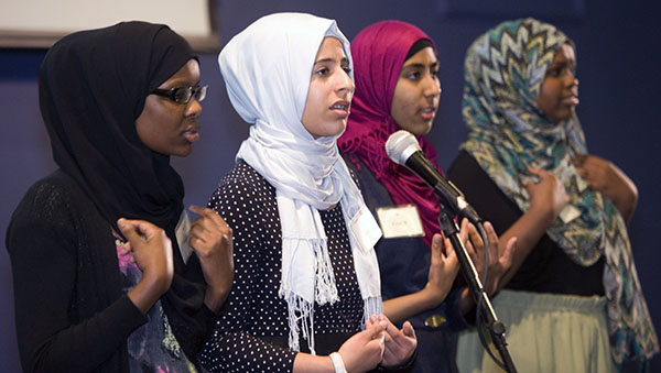 Four Muslim American girls performing slam poetry