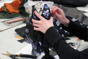 Creating a dress she designed at Providence Public Library's Fashion Forward program
