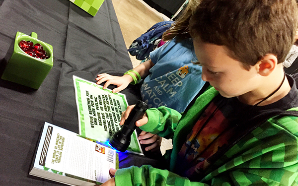children using black light in minecraft escape room
