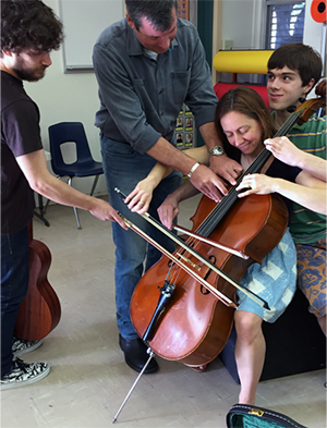 Laura Ritchie on cello with students