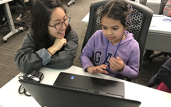 igniteCS program mentor with mentee on computer