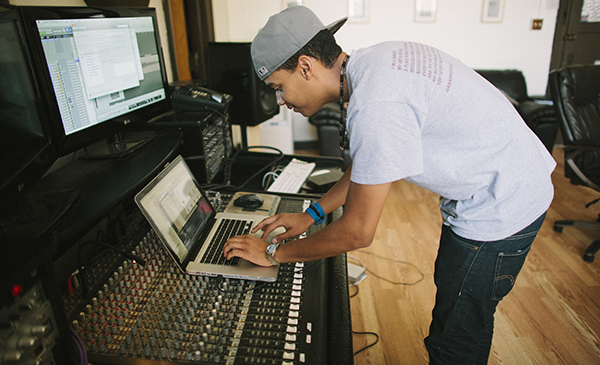 DJ creating music with laptop