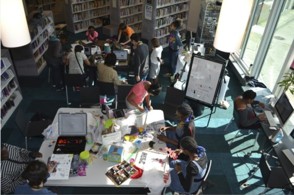 students creating projects in a library