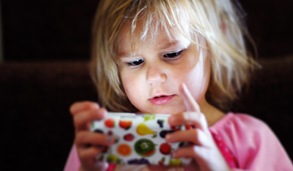 Child heavily focused on phone screen