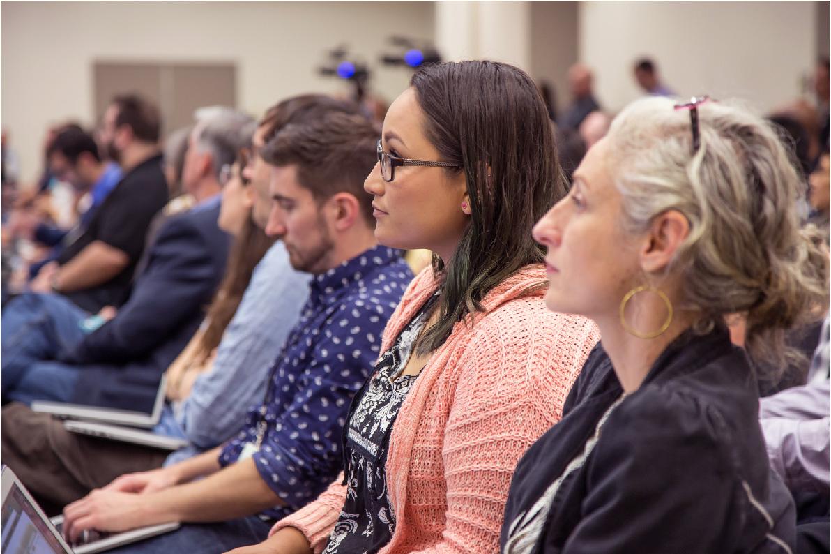 People sitting in audience listening