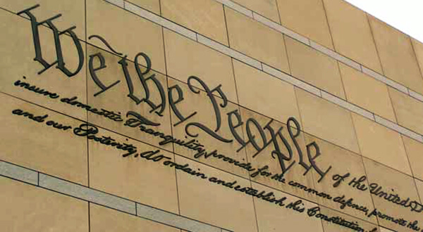 Side of a building with 'We the People' engraved on it.
