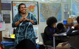 Michelle King smiling in classroom