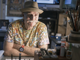 Howard Rheingold sitting at work bench