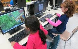 young children playing games on computer