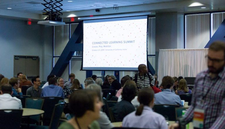 Attendees and banner from the 2019 Connected Learning Summit