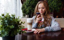Girl looking at smartphone screen