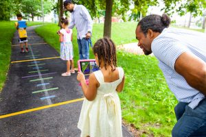 Kids play outdoor math game