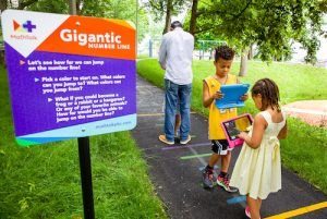 Kids playing outdoor math game