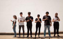 Group of teens looking at smartphones