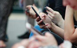 People looking at their smartphones