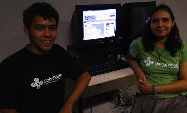 Global voices students sitting at computer in brazil