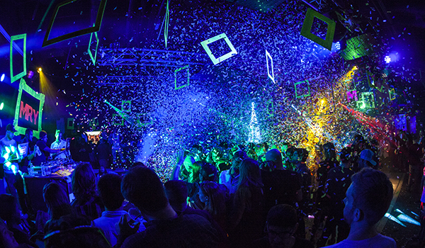 SXSW 2015 celebration in room with confetti neon lights dancing