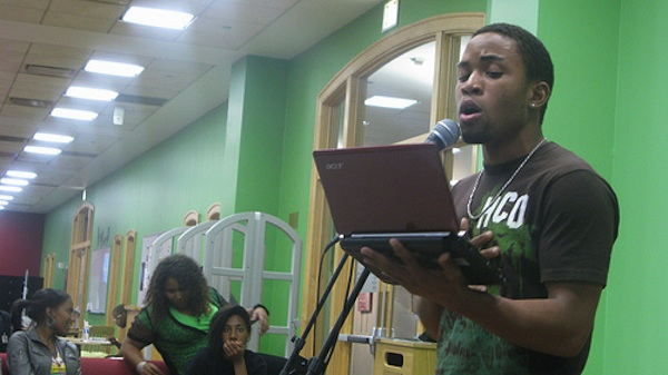 student performing spoken word at YOUmedia center