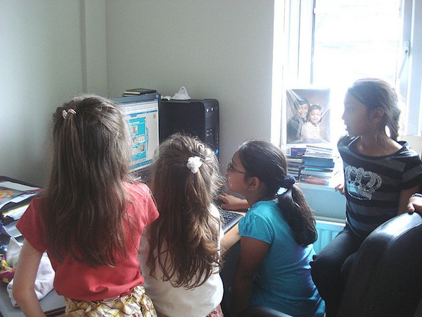 female students working on classroom computer together