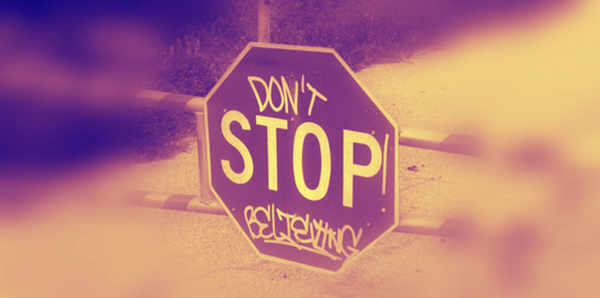 picture of stop sign with graffiti saying don't stop