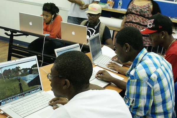 students sitting at desks playing computer learning games