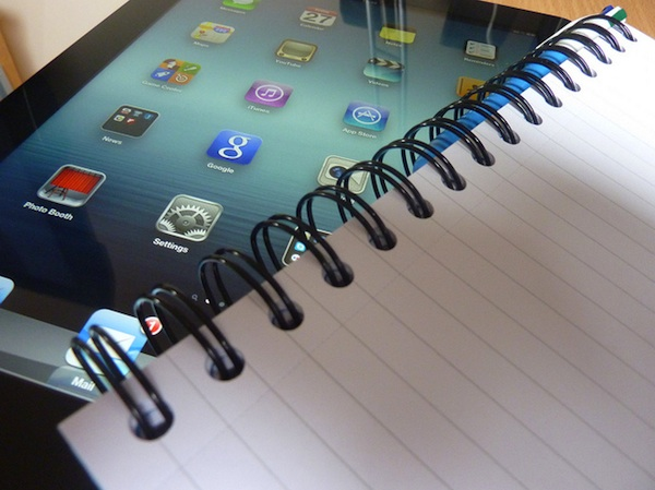 close up of ipad and spiral notebook
