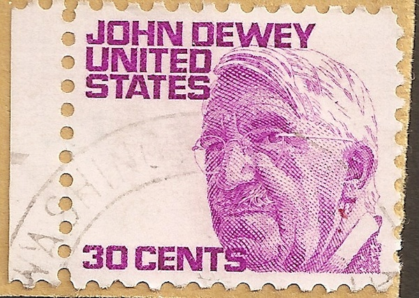 close up of old john dewey United States stamp pink ink