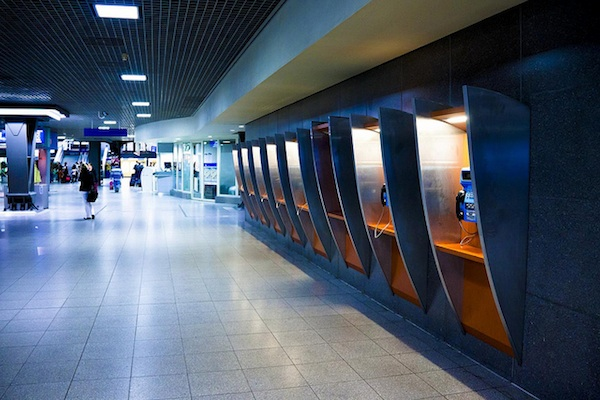 row of phone booths at the airport