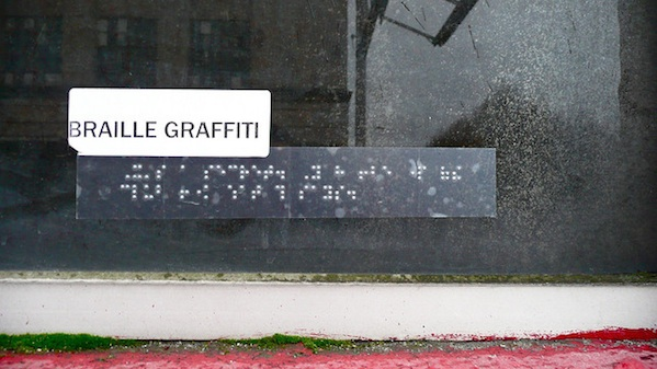 braille graffiti on glass window