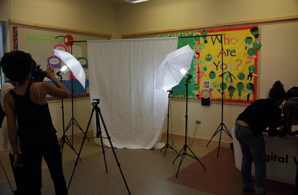 students setting up equipment to film in classroom
