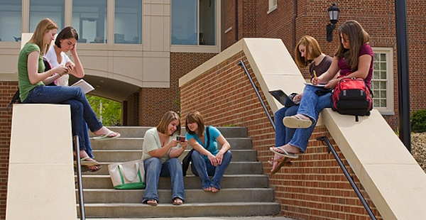 group of college girls working on outdoor steps