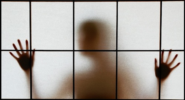 person shadow behind window