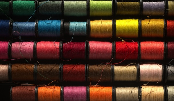 colorful stacked spools of thread