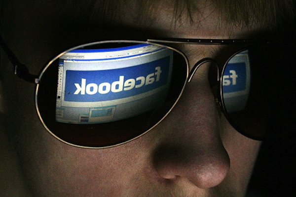 facebook homepage reflected in sunglasses