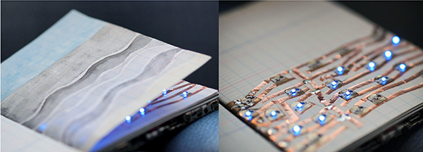 notebook with drawing and electrical wiring on pages with lights