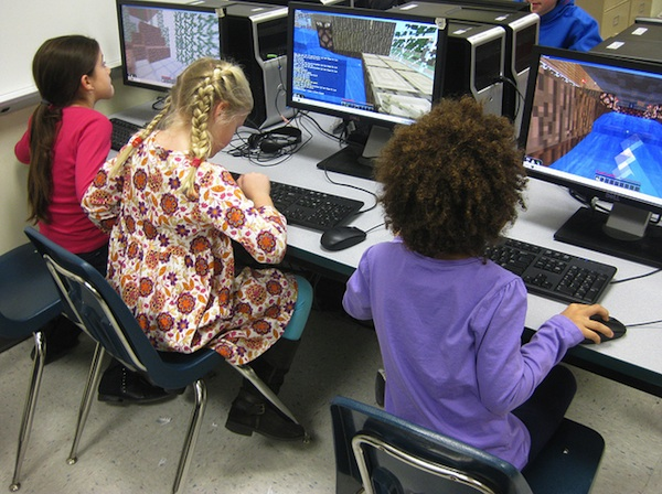 young girls at school computers playing minecraft