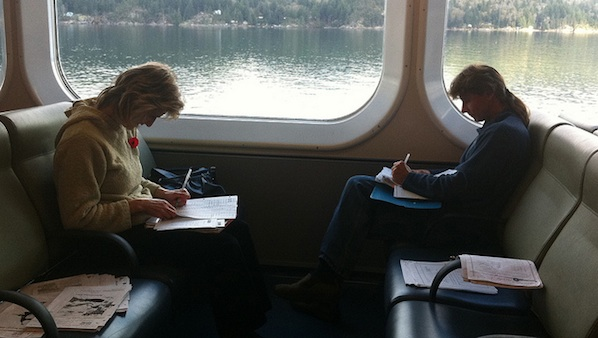 2 women doing paperwork on a train