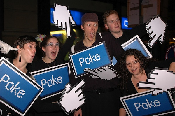 group of adults at Facebook conference holding poke and mouse signs